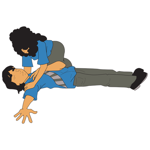 1 person putting another person in the recovery position